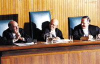Justices of the Supreme Court Major, Iaccobucci, and Binnie at the Grand Moot, 2002