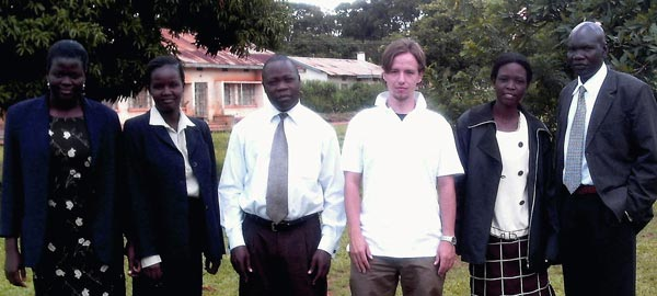 IHRP intern T.J. Riddell with staff from the Legal Aid Project of Uganda