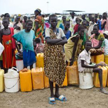 Girls waiting in line for water in the UNMISS camp near Bentiu, South Sudan