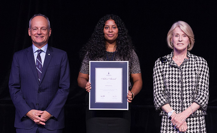 Atrisha Lewis, J.D. 2012 (centre) with her Arbor Award, flanked by U of T President Meric Gerler (left) and U of T Chancellor Rose Patten (right)