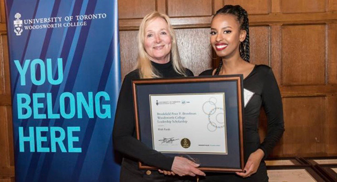 Ifrah Farah (right) receiving scholarship award