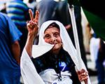 Libyian woman holding flag