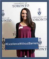 Student holding #Excellencewithoutbarriers sign