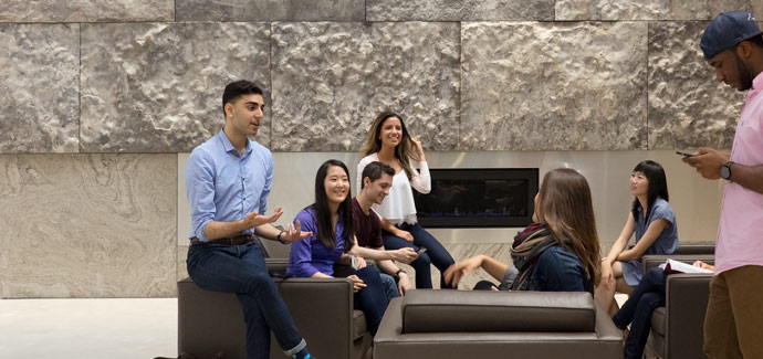 Students in front of the atrium fireplace