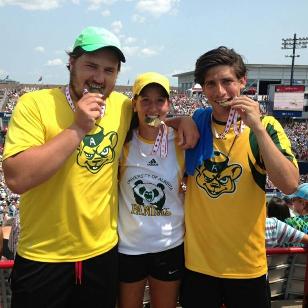 Erika Voaklander with winning medal in mixed doubles competition at U of A