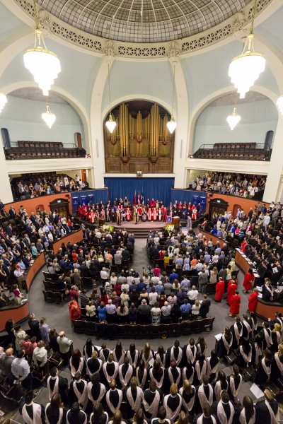 wide shot of Convocation Hall audience