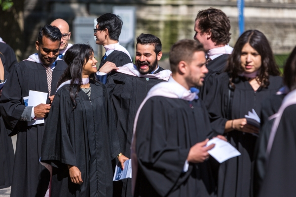 law grads walking into Convocation Hall