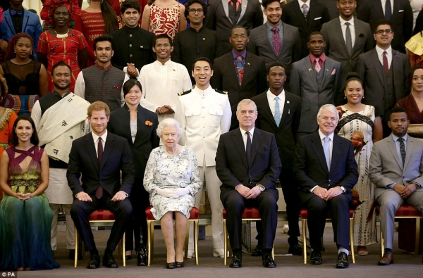 Kevin Vuong in second row standing behind the Queen