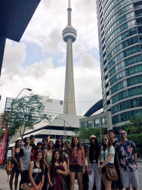 Aboriginal youth group shot in front of CN Tower