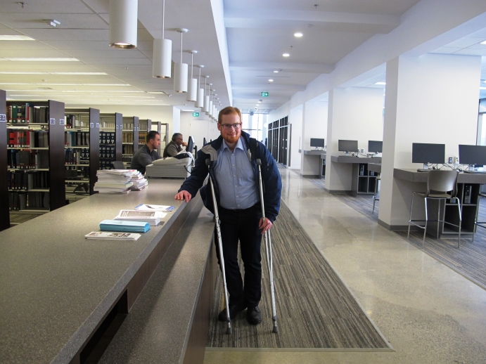 Law student Spencer Robinson by the reference desk after entering the library