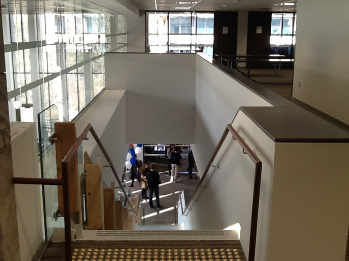View looking down staircase from law library's second floor