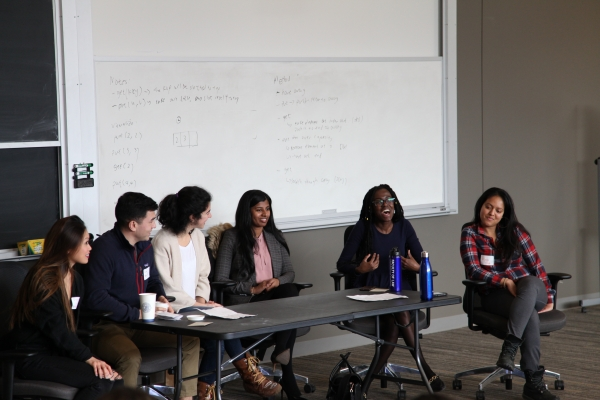 Group of diverse law students sitting on a panel about going to law school