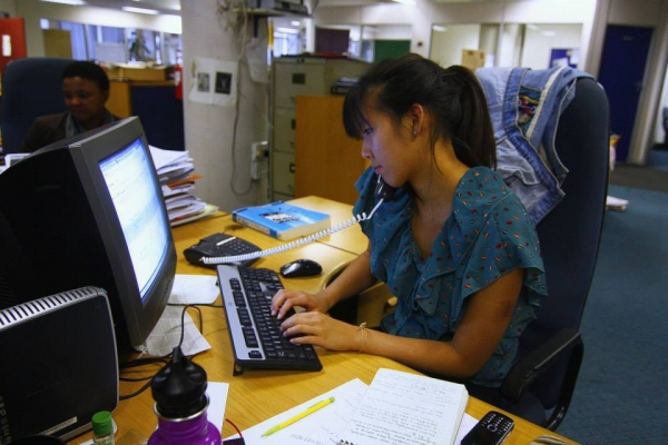 Karen Chen working in Johannesberg newsroom