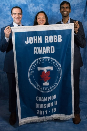 law students holding intramural banner