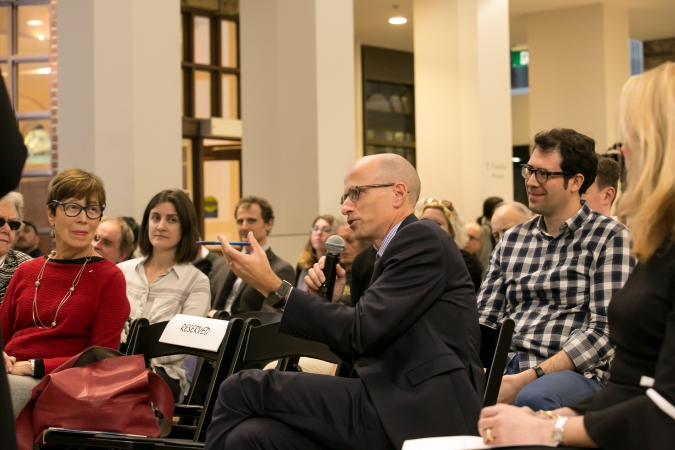 Crowd shot and Dean Iacobucci asks a question