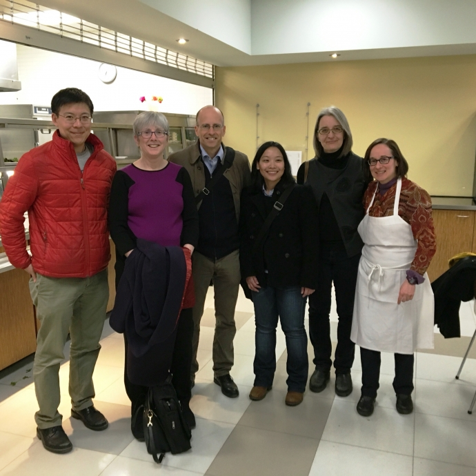 Faculty in a group photo at Lawyers Feed the Hungry cafeteria