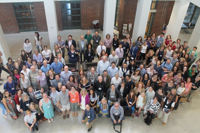 Group shot of conference attendees in the atrium of the Jackman Law Buidling
