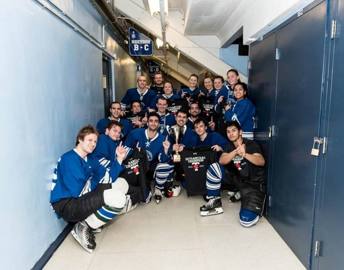 UTLaw won the intramural divisonal coed hockey title, seen here in a group shot at Varsity Arena by the lockers