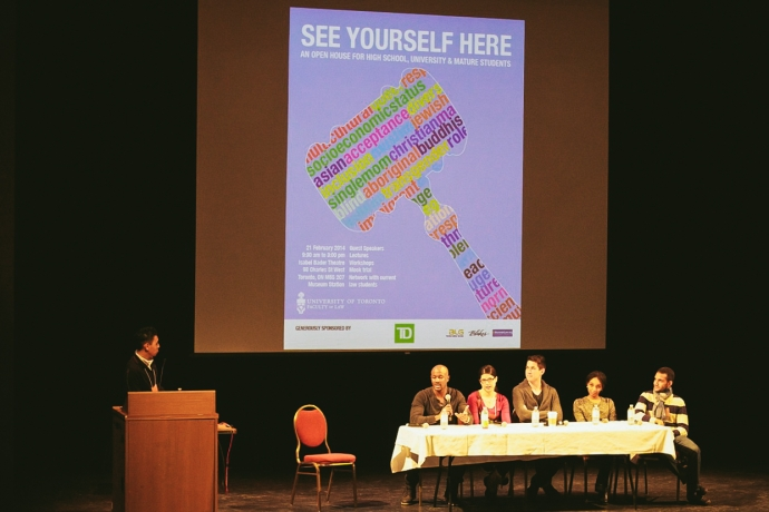 Diverse students at a panel on stage at See Yourself Here open house