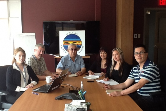 Law student Vanessa Gurr, left, with Industry Relations Corporation staff around a corporate table