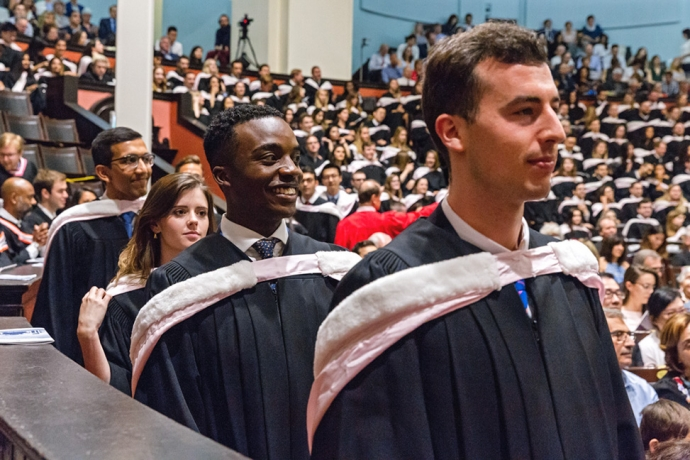 group of law students waiting to step onto dais in Convocation Hall