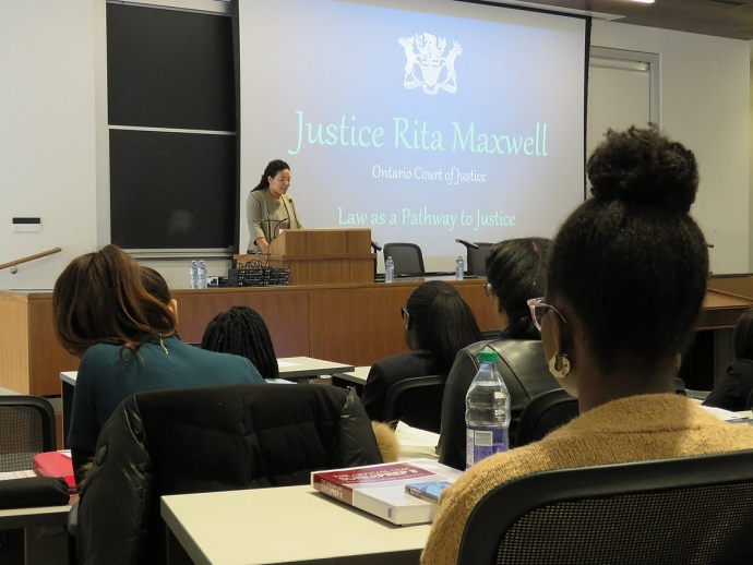 Alumna Justice Rita Maxwell presenting in front of group of black students