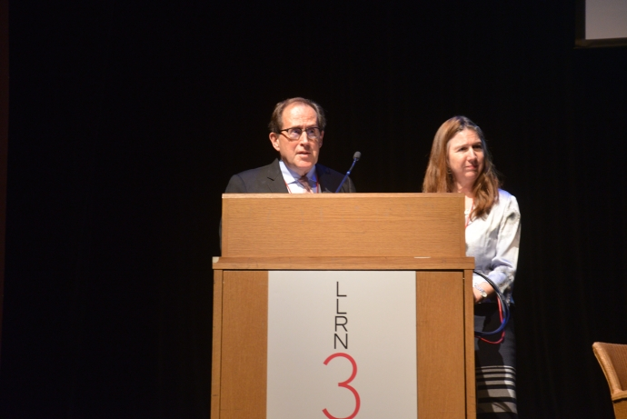 Professors Brian Langille and Kerry Rittch at the podium for LLRN Conference