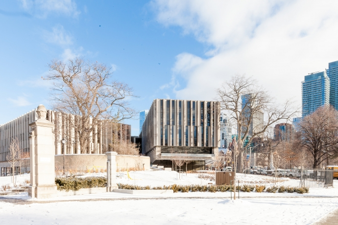 Winter scene of the Faculty of Law's Jackman Law Building looking north from Hoskin Ave. and through the Bennett Gates