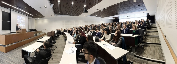 Panoramic view of the Dean addressing students at the opening of Welcome Day