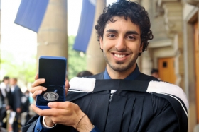 Graduate Shan Arora shows his Governor General Silver Medal