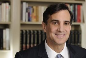 headshot of alumnus Ron Daniels, President of John Hopkins University