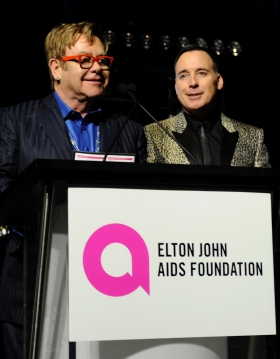 Sir Elton John and Foundation Chairman David Furnish introducing the text to pledge campaign on stage