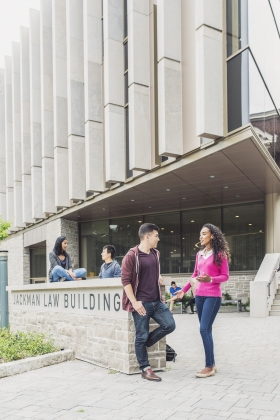 law students in front of Jackman Law Building entrance