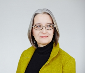 headshot of professor lisa austin